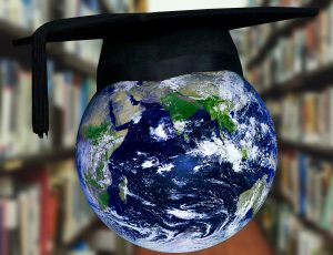Picture of the globe wearing a mortar board